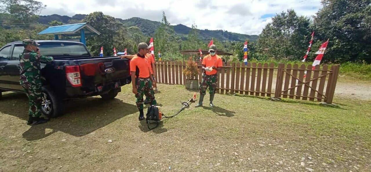 Keterlibatan Satgas PaskhaS Pos Oksibil kerja Bakti Menyambut Hut KE-75 NKRI .