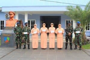 Penyaluran Bantuan Bapak/Ibu Asuh kepada Siswa/Siswi Madrasah Ibtidaiyah (MI) Angkasa Lanud Leo Wattimena