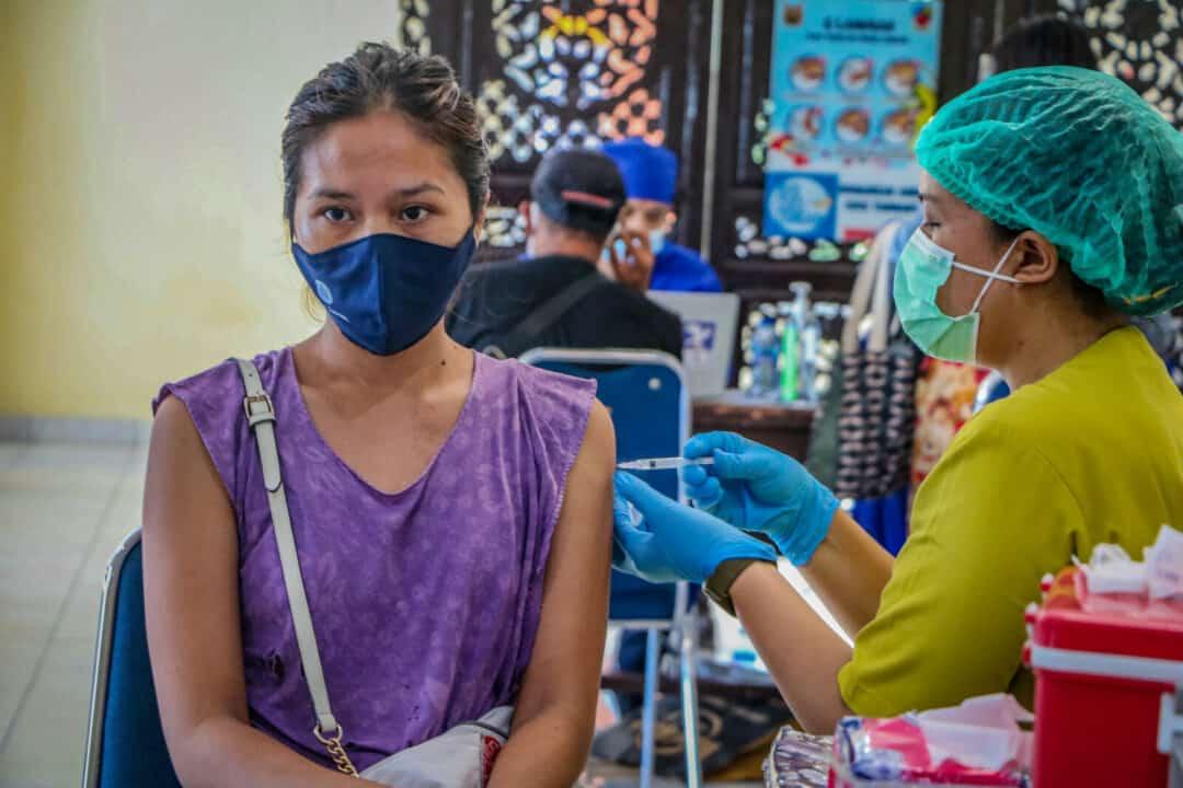 Antususias, Masyarakat Bali Menyambut Serbuan Vaksinasi di Lanud I Gusti Ngurah Rai.
